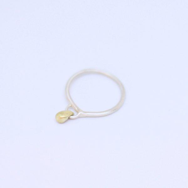 anillo plata y gota de bronce